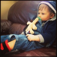 Chillin' with his boots and binkie.