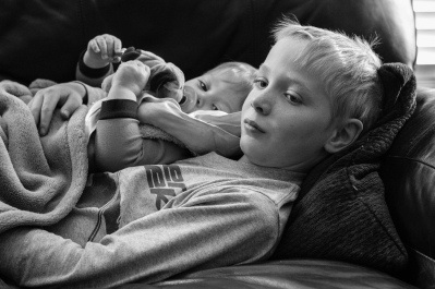 Matthew snuggling with big brother when he was sick